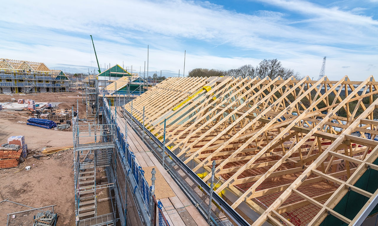 Housing development under construction. View of roof trusses